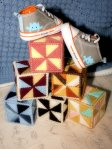 Hand-made block rattles and mighty cute monster shoes