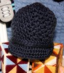 This is one of the adorable hand-knit hats we received.